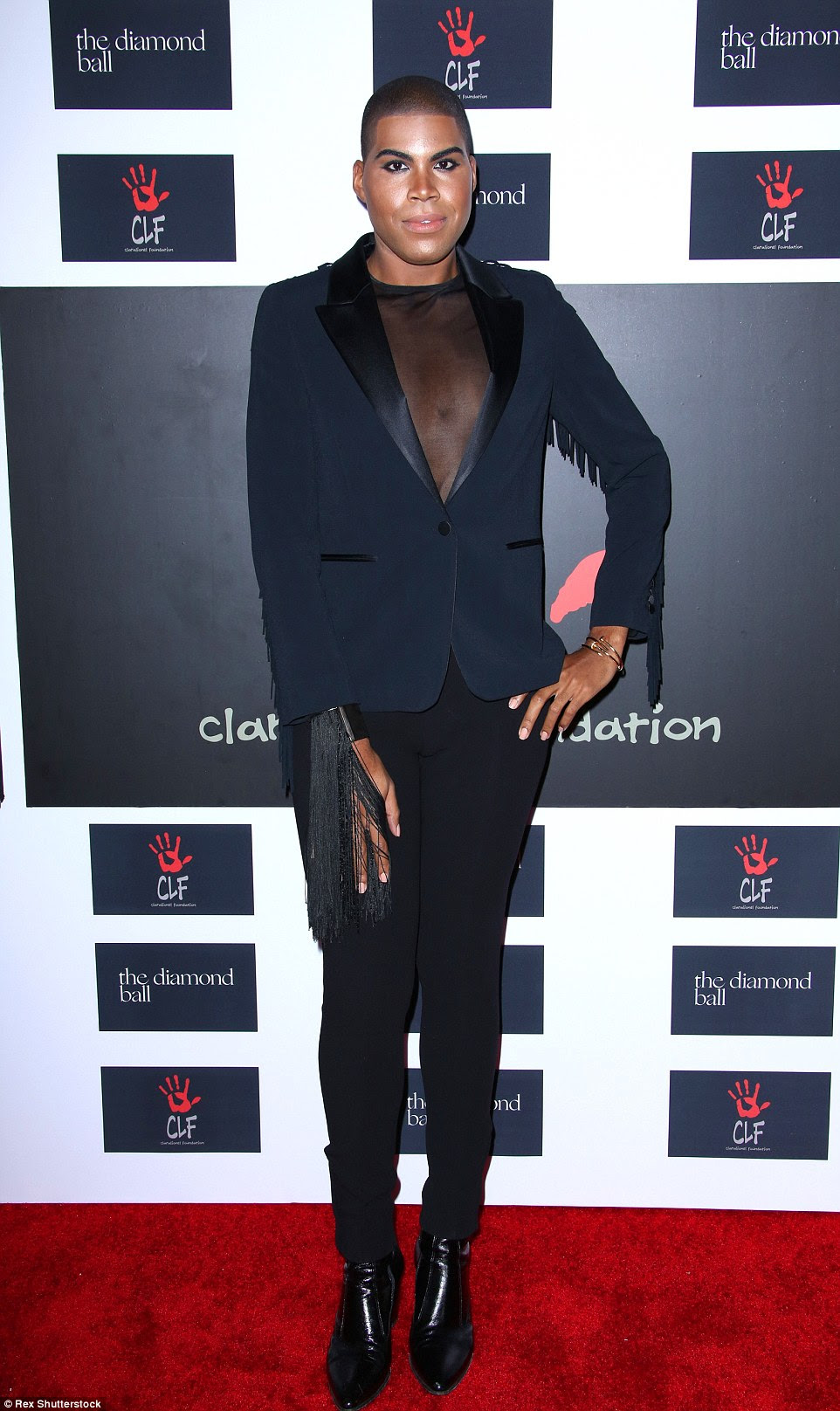 Unique style: Reality star EJ Johnson showed off his flair for fashion and impressive 180lb weight loss in a sheer top and fringed coat