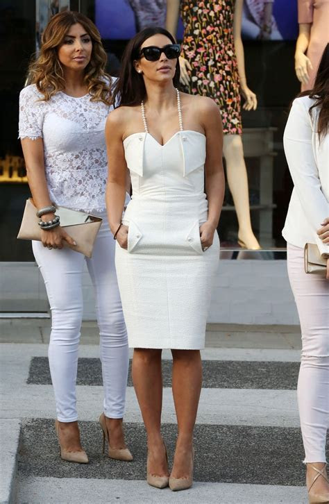 Kim Kardashian Goes Glam in White Dress With Pearls For