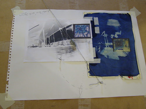 Drawing board with collage and plumb line.  by Russell Moreton