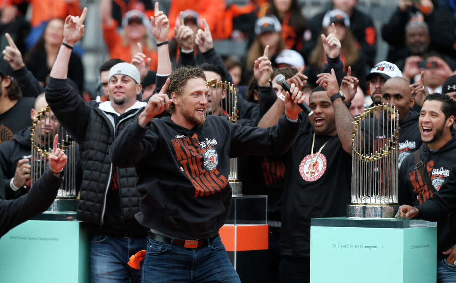 San Francisco Giants right fielder Hunter Pence leads the team and fans in a cheer during the championship parade ceremony on Friday, October 31, 2014 in the Civic Center of San Francisco, Calif. Photo: Beck Diefenbach / Special To The Chronicle / ONLINE_YES