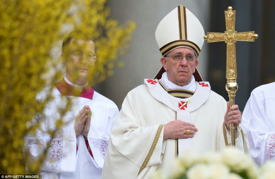 Service: Pope Francis arrives to celebrate Easter mass at the Vatican this morning
