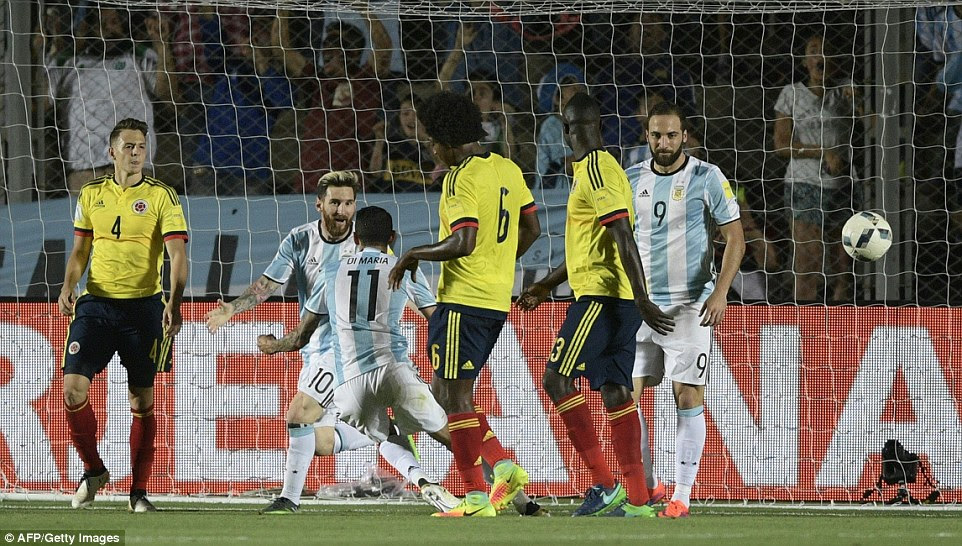 Messi (2nd left) then forced his way into the area before sqauring to Angel Di Maria (3rd left) to smash into an empty net