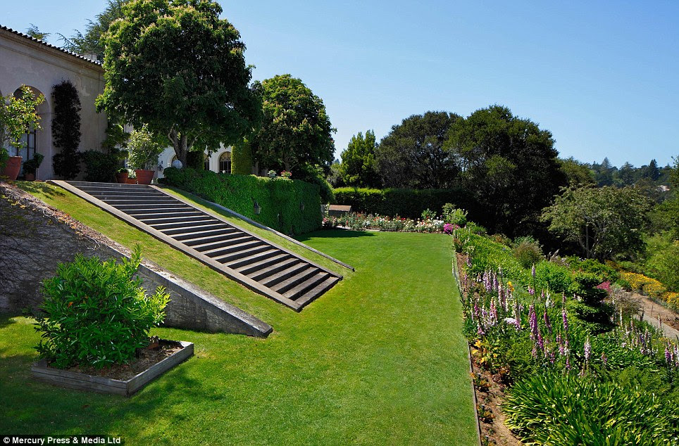 Flower power: Neighbours must be green with envy at the mansion's garden