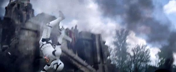 A First Order Stormtrooper is knocked into the air after getting hit by a blaster shot in STAR WARS: THE FORCE AWAKENS.
