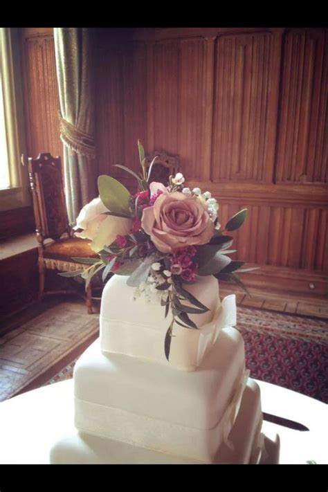 Four tier ivory square wedding cake by marks and Spencers