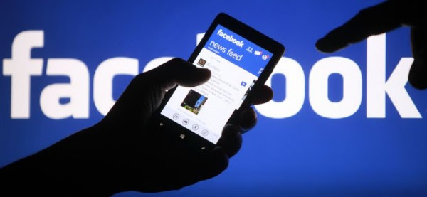 A smartphone user shows the Facebook application on his phone in Zenica, in this photo illustration