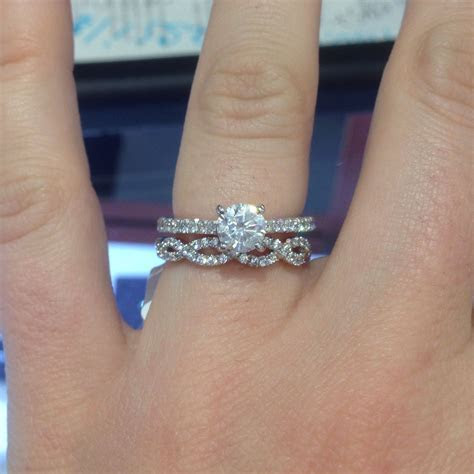 My rings!! Pave twist wedding band with solitaire round