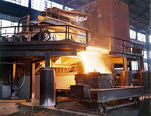 English: White-hot steel pours like water from...