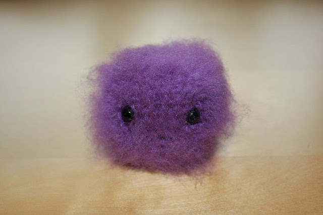 http://www.ravelry.com/projects/misshendrie/poof-pygmy-puff