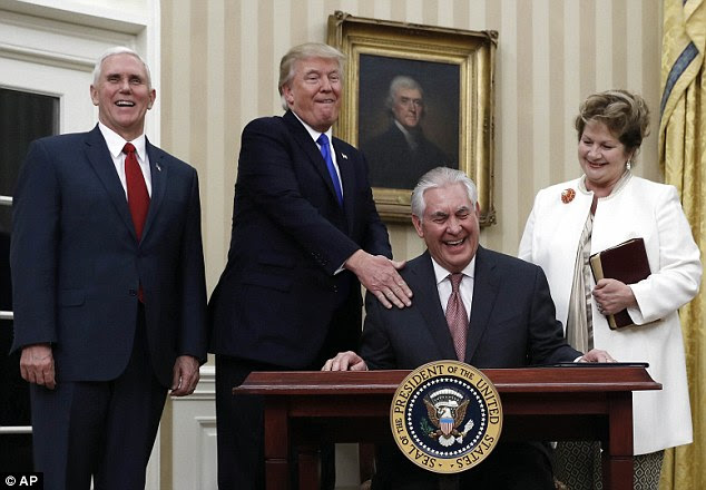 Every Republican voted for Tillerson (pictured signing the appointment affidavit) after early signals of concern about his ties to Russia and Vladimir Putin