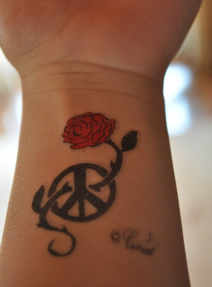 Red Rose And Black Peace Sign Tattoos On Wrist In 2017 Real Photo