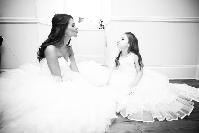 Cute photo of bride and flower girl. Post image for Melissa & Jason {Lowndes Grove Plantation}