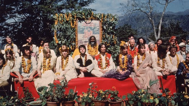The Beatles and their wives sit in Rishikesh with the Maharishi Mahesh Yogi in March 1968