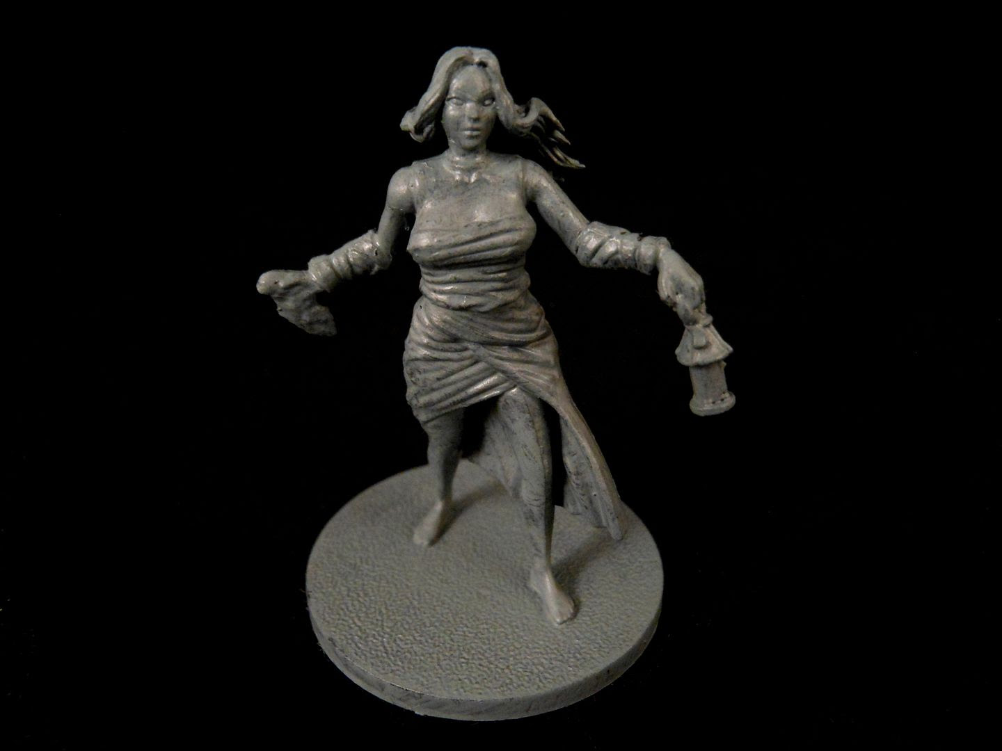 Close up photograph showing a female survivor from Kingdom Death: Monster with Uniform Grey basecoat.