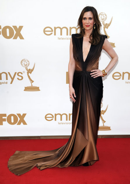 Kristen Wiig arrives at the 63rd Primetime Emmy Awards on Sunday, Sept. 18, 2011 in Los Angeles. (AP Photo/Chris Pizzello)