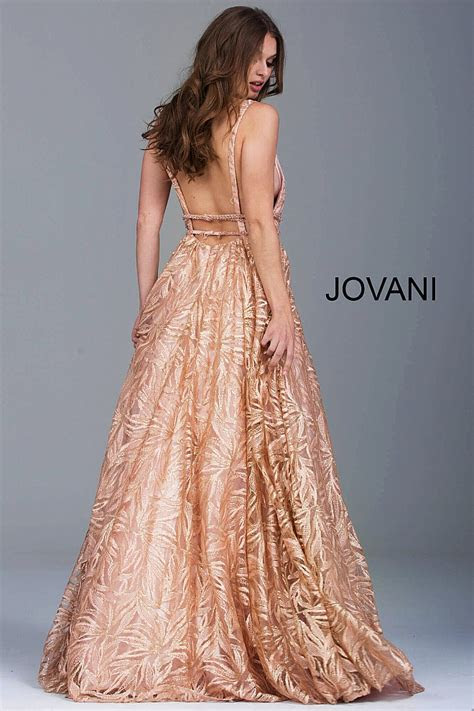 Rose gold embroidered long A line plunging neck evening gown.