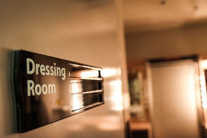 A dressing room sign.