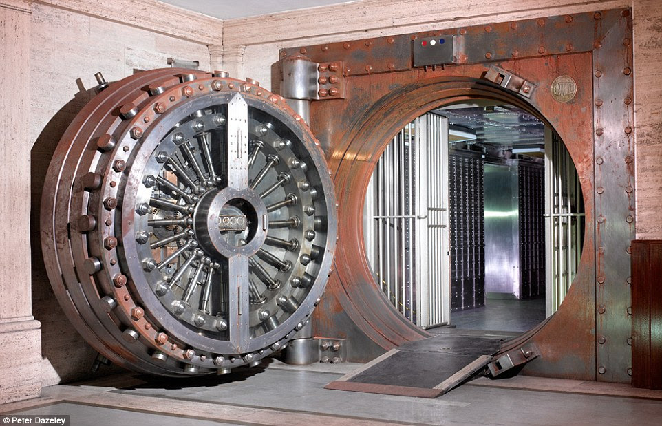 Open door: A safe deposit entrance at the Midland Bank in Poultry, with a 25-ton vault door, guarding 3,800 private boxes of varying sizes