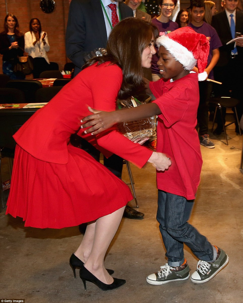 Kate's appearance at the centre provoked much excitement with youngsters dressed in Santa Claus hats keen to give her a hug