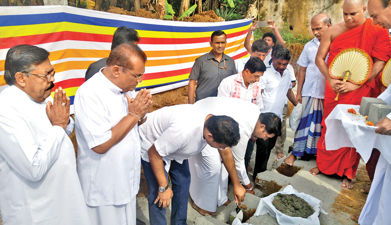 State Defence Minister Ruwan Wijewardene laying the foundation stone for the dharma shalawa. Picture by Oswald Godakumbura, Rambukkana Special Corr.