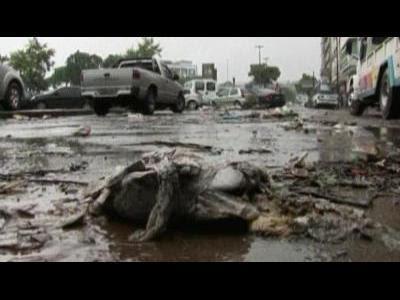 Rio cleans up as rain continues