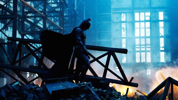 Batman (Christian Bale) surveys the wreckage following the death of Rachel Dawes (Maggie Gyllenhaal) in THE DARK KNIGHT.