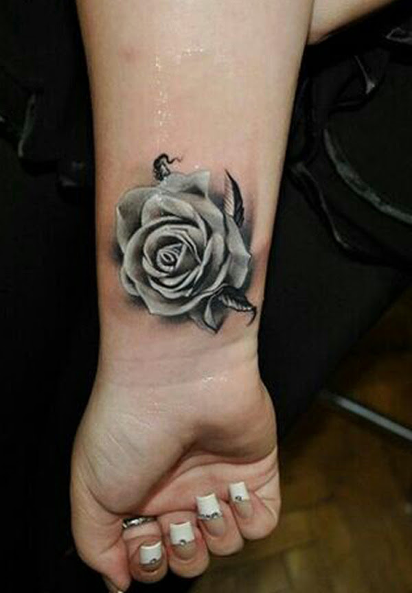 Grey Ink Rose Flower Tattoo On Wrist