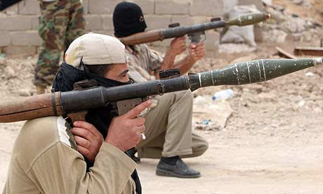 Mahdi army militiamen aim RPGs in Basra