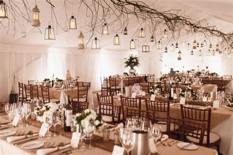 Winter, wedding marquee  twigs, lanterns, wooden planks