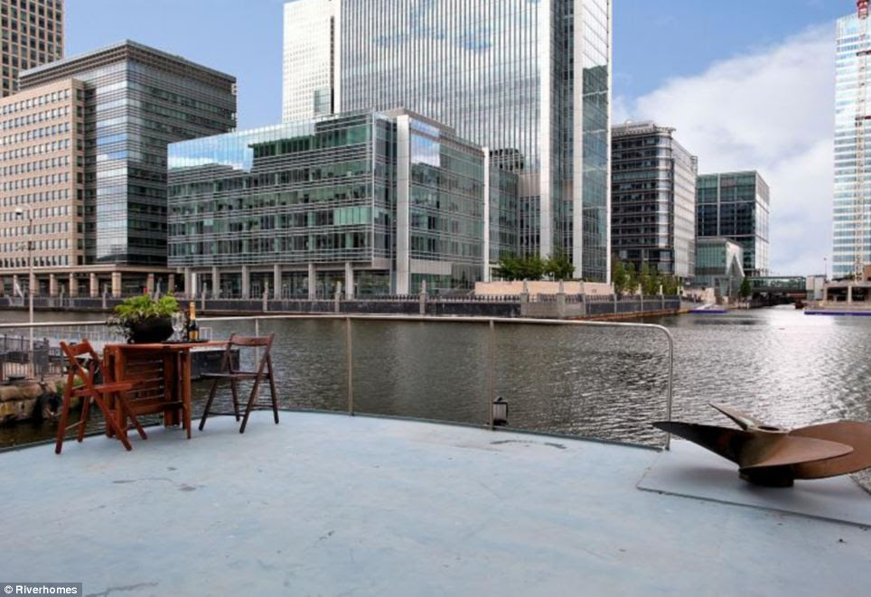 Prime location: With its own private decking, the owner of Le Sorelle has a perfect view of Canary Wharf's grand sky scrapers