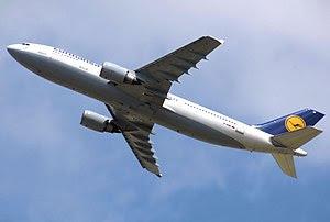 A Lufthansa A300B4-603 departs London Heathrow...