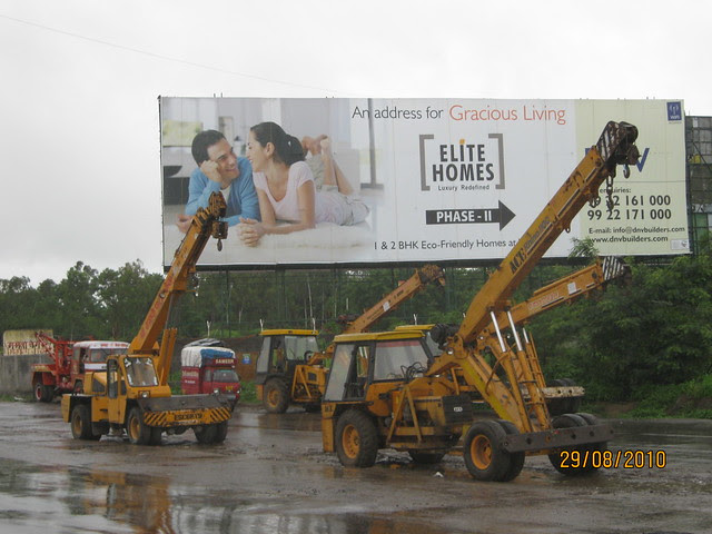 Elite Homes hoarding on the service road at Wakad Pune