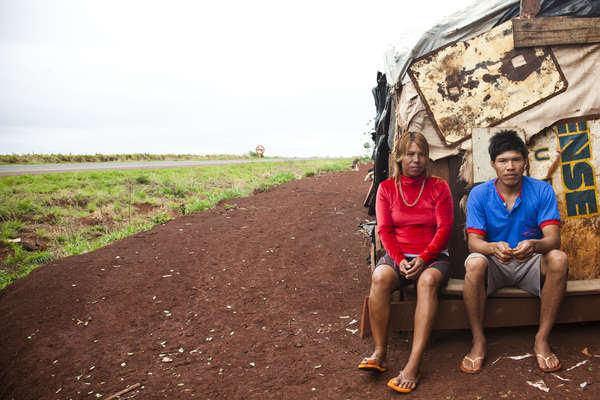 A Guarani-Kaiowa couple outside their makeshift roadside settlement of Apyka'y, near Dourados, Brazil.