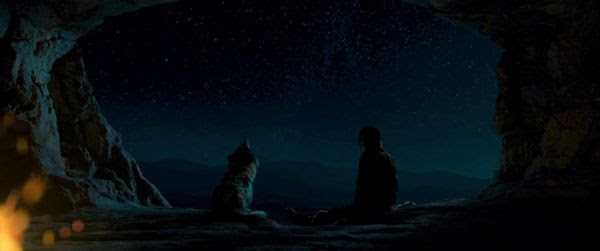 Keda (Kodi Smit-McPhee) and a wolf he rescued from a severe injury look up at the stars in ALPHA.