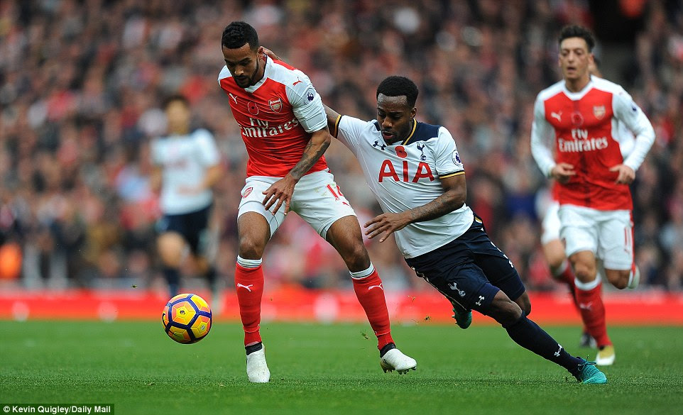 England team-mates Theo Walcott (left) and Danny Rose (right) compete for the ball during Sunday's match in north London