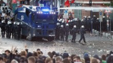 """Riot police use water cannon during the """"Welcome to Hell"""" rally against the G20 summit in Hamburg, northern Germany on July 6, 2017."""