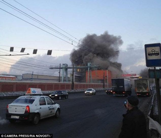 Hit: The stadium of Chelyabinsk's Traktor ice hockey side was hit and state television showed a part of the roof and a wall shorn off a brick zinc factory in the city