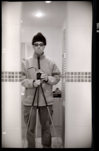 reflected self-portrait with Bilora Boy camera and pointy hat by pho-Tony