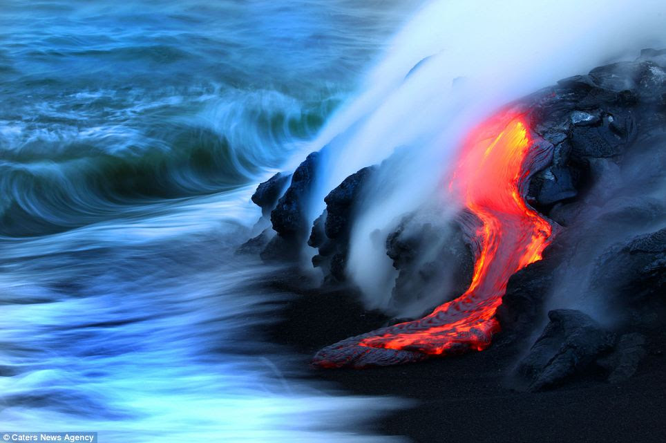 Nature's fury: Nick Selway, 28, and CJ Kale, 35, braved baking hot 110F waters to capture these images, as they floated just feet from scalding heat and floating lava bombs