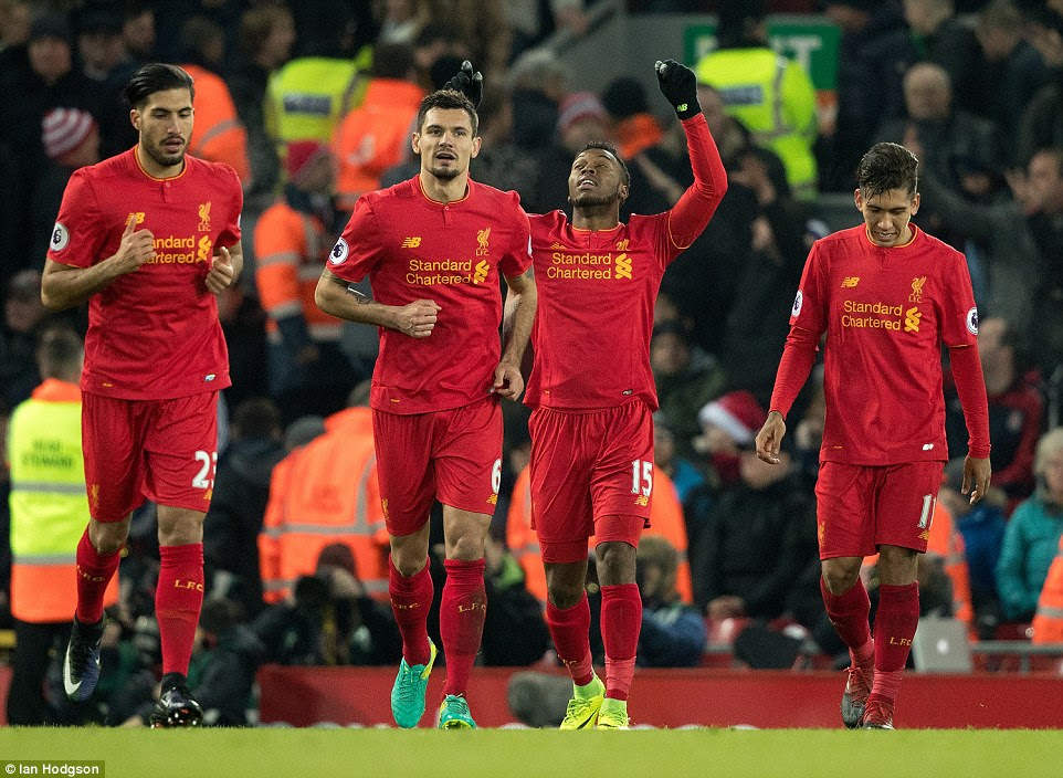 Liverpool's players celebrate after Daniel Sturridge's goal with his first effort secured victory at Anfield on Tuesday evening