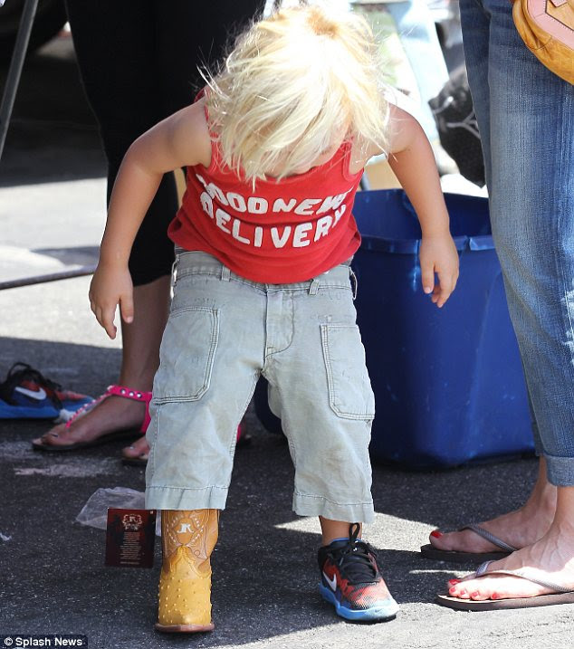 Making his mind up: Zuma, three, tried on a pair of adorable cowboy boots