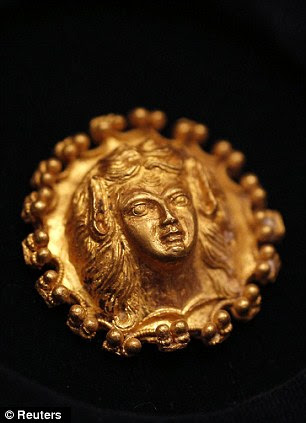A pair of golden artifacts that date back to the end of the fourth or the beginning of the third century BC