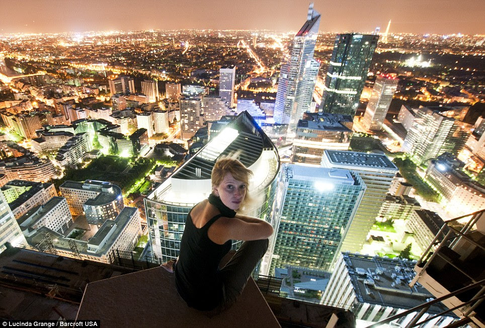 Ms Grange on top the Carpe Diem building at night in the central business district of Paris