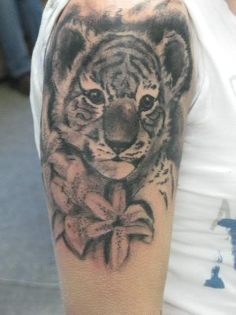 Grey Ink Flowers And Tiger Tattoo On Right Half Sleeve