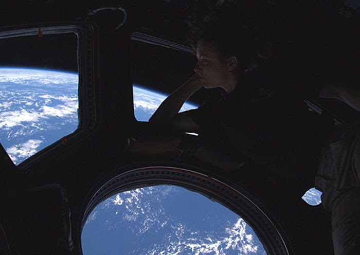 Astronaut Tracy Caldwell Dyson gazes through the Cupola window at Earth in late September of 2010.