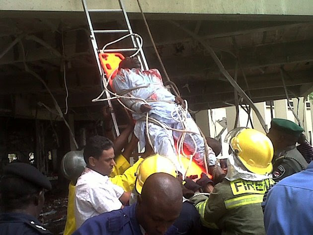 This image released by Saharareporters shows an injured man being stretchered down a ladder by firefighters after a large explosion struck the United Nations' main office in Nigeria's capital Abuja Fr