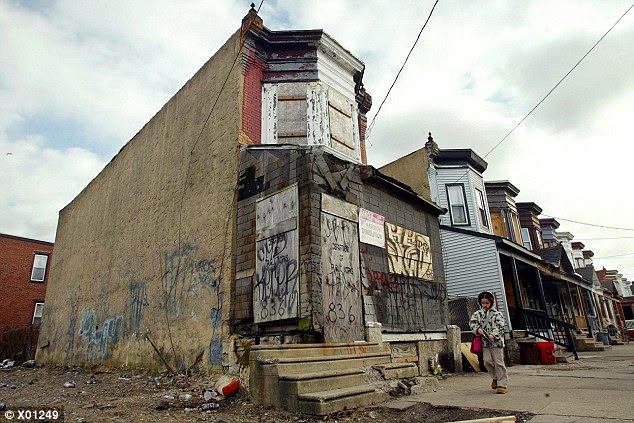 Decay: Soaring unemployment and the flight of thousands of city residents has resulted in urban blight spreading across the city