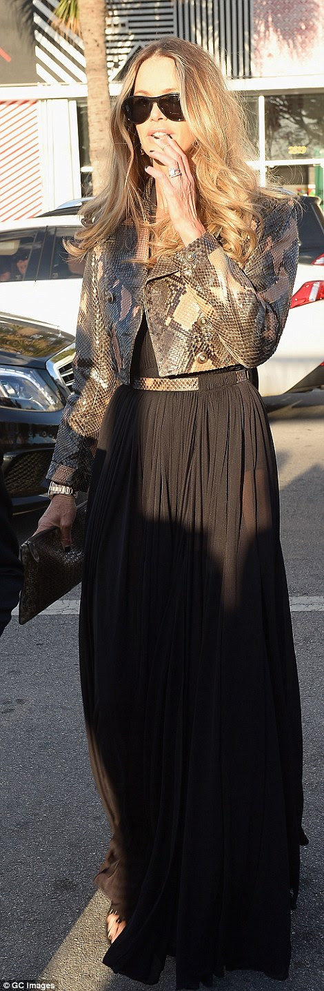 Elle Macphersonwas also a little more demure than most, covering up in a cropped snakeskin jacket