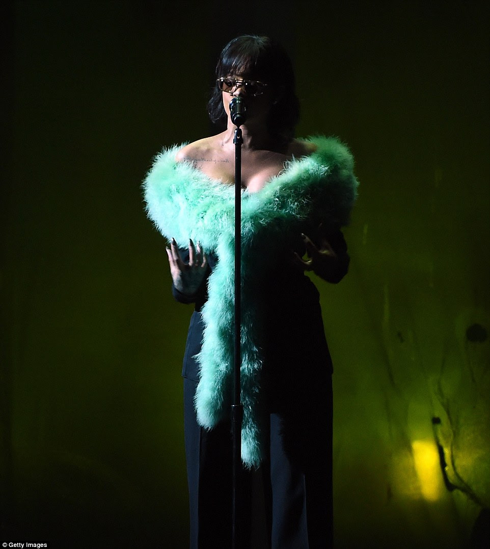 Retro chic: Earlier in the night Rihanna performed new single Love On The Brain