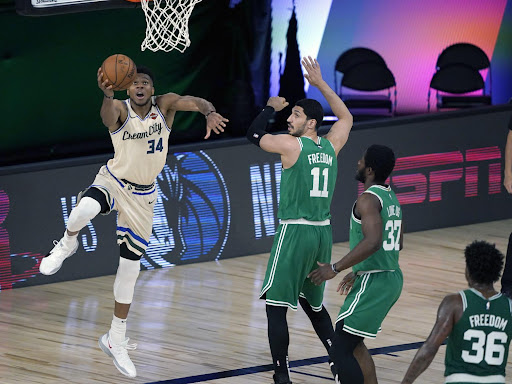 Avatar of Photos: Milwaukee Bucks return to action with win over Boston Celtics